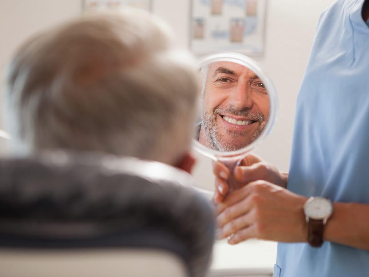 Dental Implants vs Dentures in Red Deer